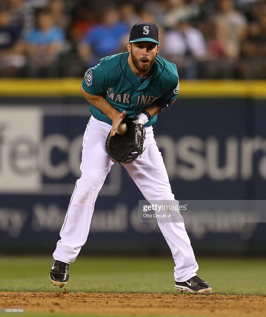 First baseman <a gi-track='captionPersonalityLinkClicked' href=/galleries/search?phrase=Dustin+Ackley&family=editorial&specificpeople=4352278 ng-click='$event.stopPropagation()'>Dustin Ackley</a> #13 of the Seattle Mariners fields a sharp grounder by Ben Zobrist of the Tampa Bay Rays at Safeco Field on August 13, 2012 in Seattle, Washington.