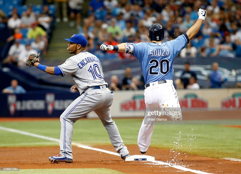 First baseman <a gi-track='captionPersonalityLinkClicked' href=/galleries/search?phrase=Edwin+Encarnacion&family=editorial&specificpeople=598285 ng-click='$event.stopPropagation()'>Edwin Encarnacion</a> #10 of the Toronto Blue Jays hauls in the throw from second baseman Ryan Goins for the out at first base on <a gi-track='captionPersonalityLinkClicked' href=/galleries/search?phrase=Steven+Souza+-+Jogador+de+basebol&family=editorial&specificpeople=12493609 ng-click='$event.stopPropagation()'>Steven Souza</a> Jr. #20 of the Tampa Bay Rays to end the first inning of a game on May 1, 2016 at Tropicana Field in St. Petersburg, Florida.