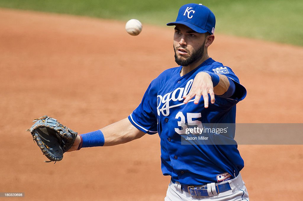 First baseman <a gi-track='captionPersonalityLinkClicked' href=/galleries/search?phrase=Eric+Hosmer&family=editorial&specificpeople=7091345 ng-click='$event.stopPropagation()'>Eric Hosmer</a> #35 of the Kansas City Royals throws to first during the third inning of the Cleveland Indians at Progressive Field on September 11, 2013 in Cleveland, Ohio. The Royals defeated the Indians 6-2.