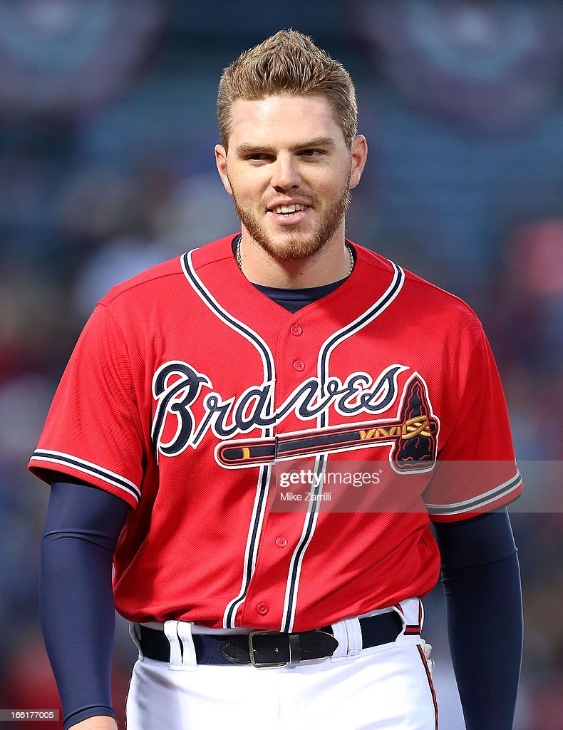 First baseman Freddie Freeman #5 of the Atlanta Braves awaits his glove and hat in between innings during the game against the Chicago Cubs at Turner Field on April 5, 2013 in Atlanta, Georgia.