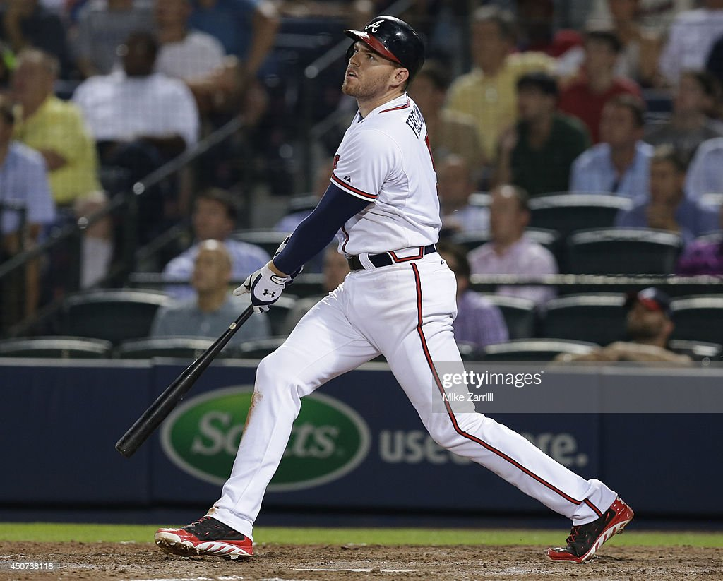 First baseman <a gi-track='captionPersonalityLinkClicked' href=/galleries/search?phrase=Freddie+Freeman&family=editorial&specificpeople=5743987 ng-click='$event.stopPropagation()'>Freddie Freeman</a> #5 of the Atlanta Braves follows through on a swing and hits a triple in the ninth inning during the game against the Philadelphia Phillies at Turner Field on June 16, 2014 in Atlanta, Georgia.