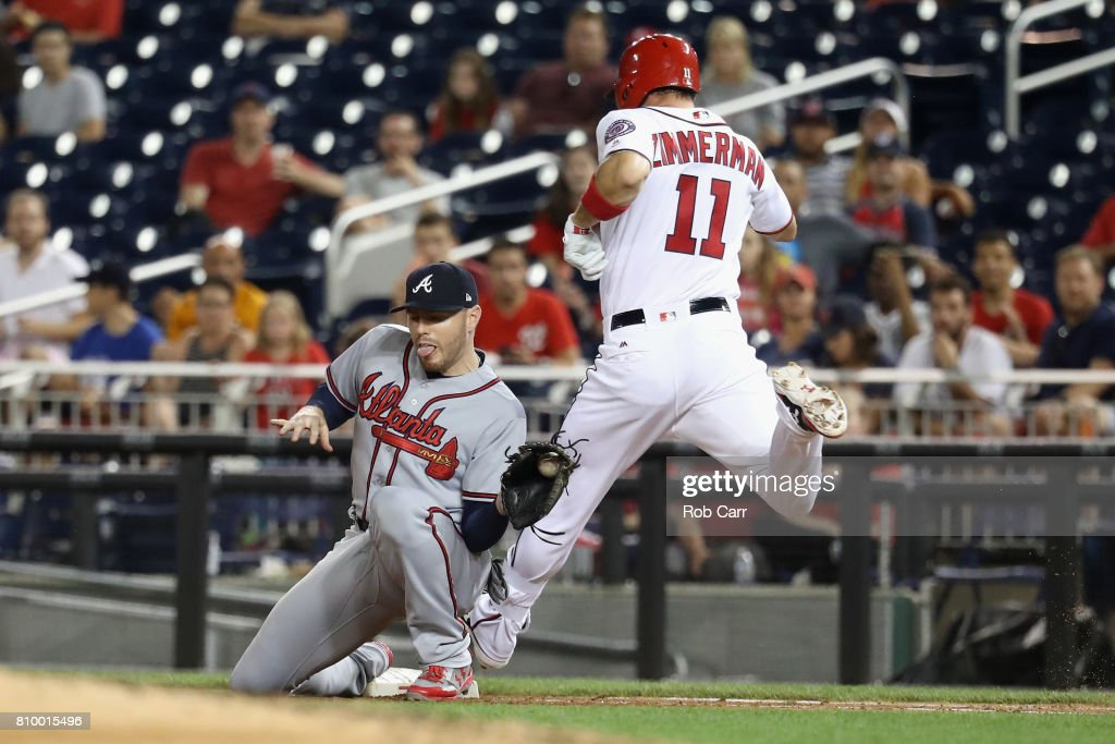 First baseman Freddie Freeman #5 of the Atlanta Braves forces out Ryan Zimmerman #11 of the Washington Nationals for the third out of the third inning at Nationals Park on July 6, 2017 in Washington, DC.