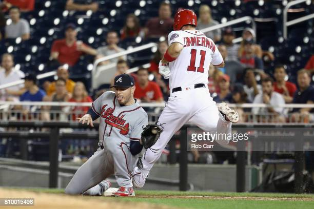 First baseman Freddie Freeman of the Atlanta Braves forces out Ryan Zimmerman of the Washington Nationals for the third out of the third inning at...