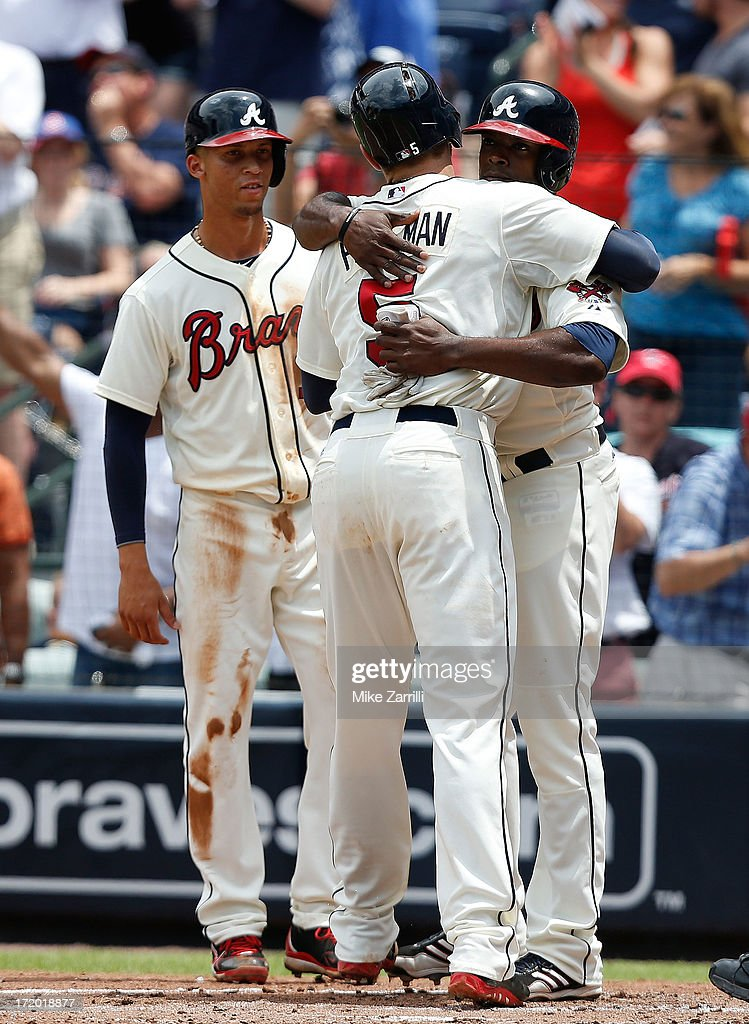First baseman <a gi-track='captionPersonalityLinkClicked' href=/galleries/search?phrase=Freddie+Freeman&family=editorial&specificpeople=5743987 ng-click='$event.stopPropagation()'>Freddie Freeman</a> #5 of the Atlanta Braves (center) is congratulated by centerfielder <a gi-track='captionPersonalityLinkClicked' href=/galleries/search?phrase=B.J.+Upton&family=editorial&specificpeople=810704 ng-click='$event.stopPropagation()'>B.J. Upton</a> #2 (right) while shortstop <a gi-track='captionPersonalityLinkClicked' href=/galleries/search?phrase=Andrelton+Simmons&family=editorial&specificpeople=8978424 ng-click='$event.stopPropagation()'>Andrelton Simmons</a> #19 looks on during the game against the Arizona Diamondbacks at Turner Field on June 30, 2013 in Atlanta, Georgia.