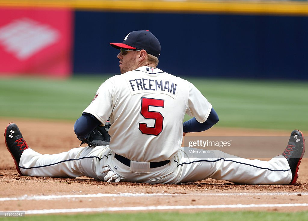 First baseman <a gi-track='captionPersonalityLinkClicked' href=/galleries/search?phrase=Freddie+Freeman&family=editorial&specificpeople=5743987 ng-click='$event.stopPropagation()'>Freddie Freeman</a> #5 of the Atlanta Braves sits on the ground after a stretch that narrowly missed closing out a double play during the game against the Arizona Diamondbacks at Turner Field on June 30, 2013 in Atlanta, Georgia.
