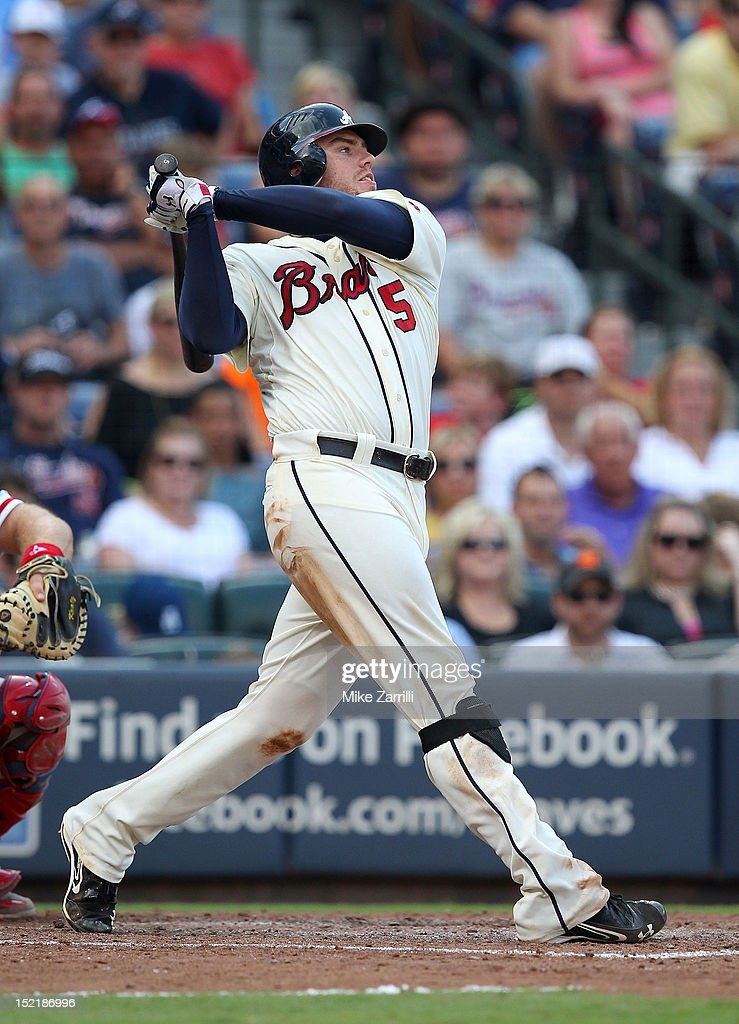 First baseman <a gi-track='captionPersonalityLinkClicked' href=/galleries/search?phrase=Freddie+Freeman&family=editorial&specificpeople=5743987 ng-click='$event.stopPropagation()'>Freddie Freeman</a> #5 of the Atlanta Braves swings during the game against the Philadelphia Phillies at Turner Field on September 1, 2012 in Atlanta, Georgia.
