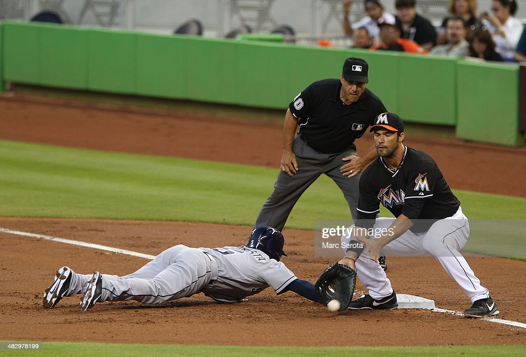 First baseman Garrett Jones of the Miami Marlins attempts to pick off Alexi Amarista of the San Diego Padres during the third inning at Marlins Park...