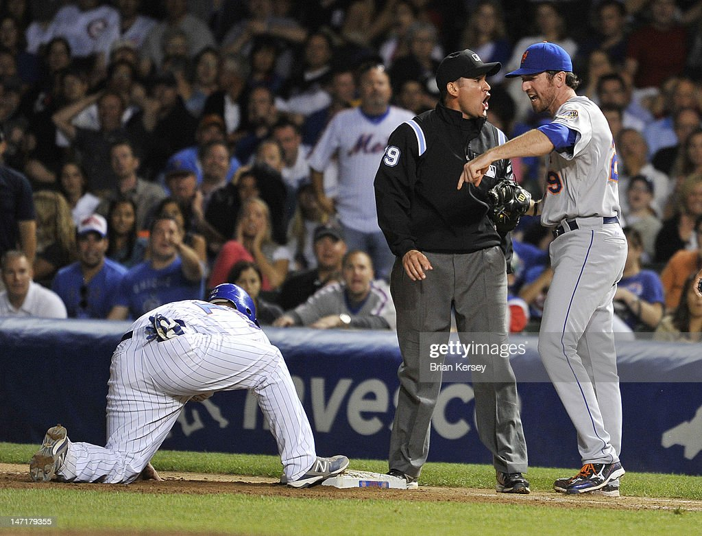 First baseman <a gi-track='captionPersonalityLinkClicked' href=/galleries/search?phrase=Ike+Davis&family=editorial&specificpeople=2349664 ng-click='$event.stopPropagation()'>Ike Davis</a> #29 of the New York Mets (R) argues with first base umpire Manny Gonzalez (C) after Gonzalez called Steve Clevenger #51 of the Chicago Cubs safe at first on a pickoff play during the eighth inning at Wrigley Field on June 26, 2012 in Chicago, Illinois. Gonzalez ejected Davis for arguing.