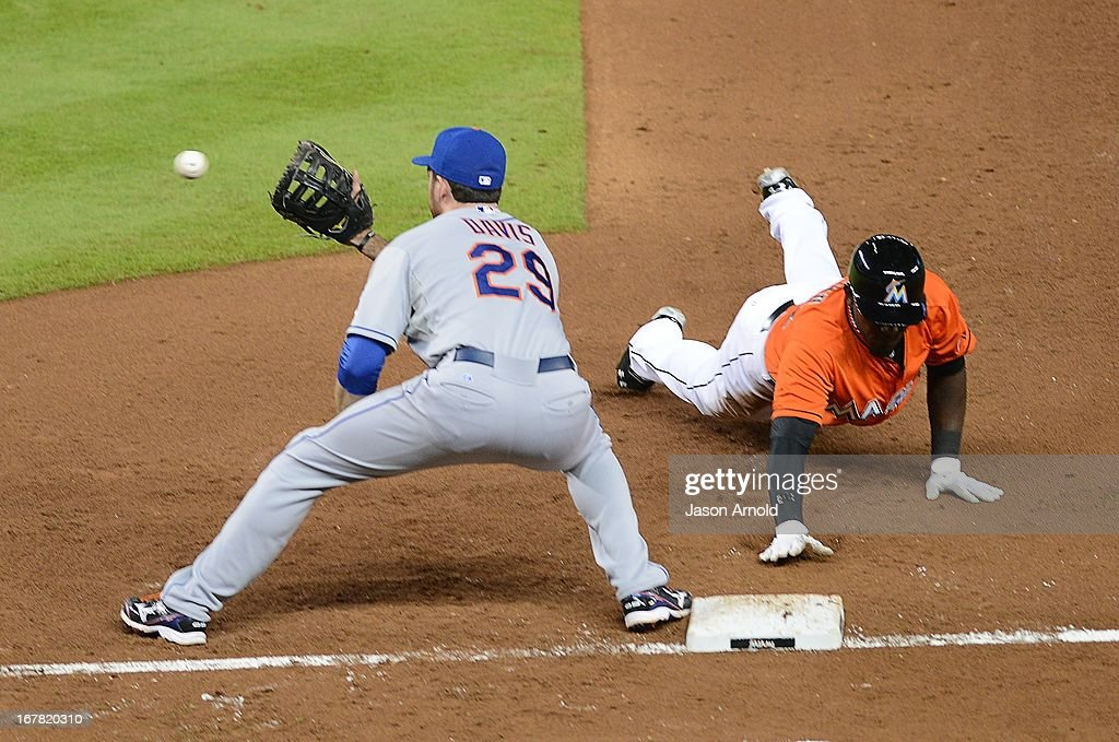 First baseman Ike Davis #29 of the New York Mets attempts to pick off Marcell Ozuna #48 of the Miami Marlins at Marlins Park on April 30, 2013 in Miami, Florida.