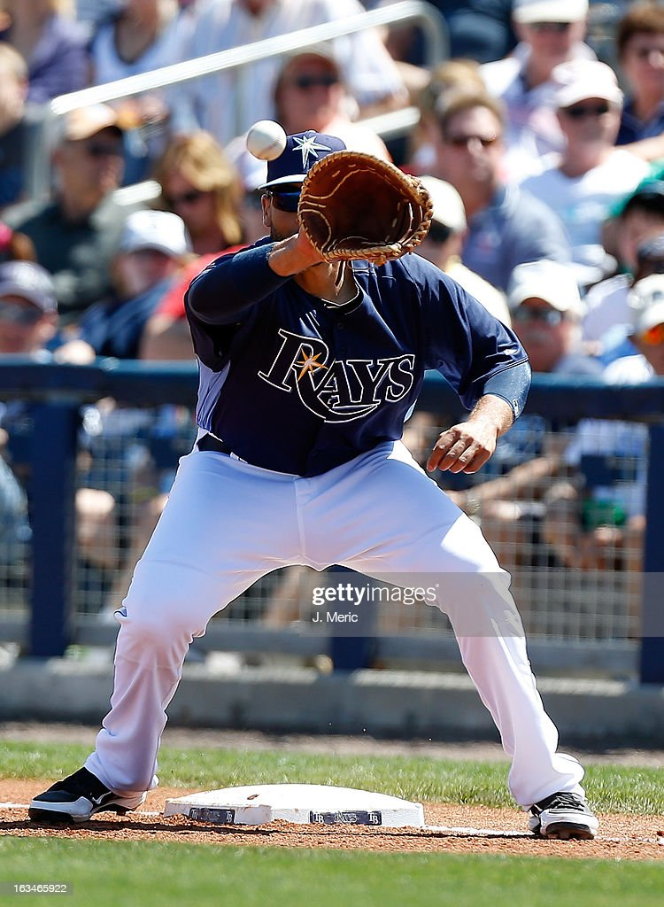 First baseman <a gi-track='captionPersonalityLinkClicked' href=/galleries/search?phrase=James+Loney&family=editorial&specificpeople=636293 ng-click='$event.stopPropagation()'>James Loney</a> #21 of the Tampa Bay Rays takes the throw at first against the Boston Red Sox during a Grapefruit League Spring Training Game at the Charlotte Sports Complex on March 10, 2013 in Port Charlotte, Florida.