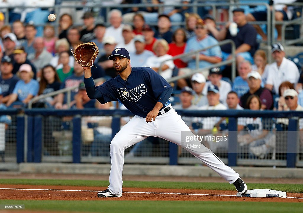 First baseman <a gi-track='captionPersonalityLinkClicked' href=/galleries/search?phrase=James+Loney&family=editorial&specificpeople=636293 ng-click='$event.stopPropagation()'>James Loney</a> #21 of the Tampa Bay Rays takes the throw at first base against the Minnesota Twins during a Grapefruit League spring training game at the Charlotte Sports Complex on March 11, 2013 in Port Charlotte, Florida.