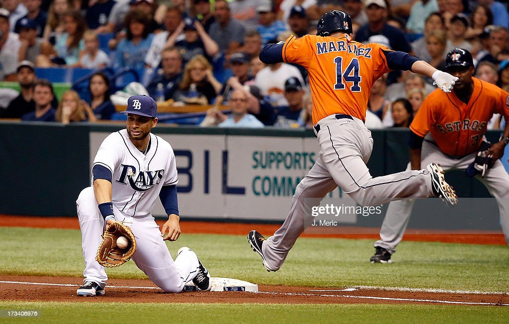 First baseman <a gi-track='captionPersonalityLinkClicked' href=/galleries/search?phrase=James+Loney&family=editorial&specificpeople=636293 ng-click='$event.stopPropagation()'>James Loney</a> #21 of the Tampa Bay Rays takes the throw at first to get the out on <a gi-track='captionPersonalityLinkClicked' href=/galleries/search?phrase=J.D.+Martinez&family=editorial&specificpeople=7520024 ng-click='$event.stopPropagation()'>J.D. Martinez</a> #14 of the Houston Astros during the game at Tropicana Field on July 13, 2013 in St. Petersburg, Florida.