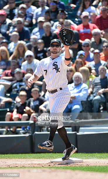 First baseman Jeff Keppinger of the Chicago White Sox catches the ball against the Detroit Tigers at US Cellular Field on August 14 2013 in Chicago...