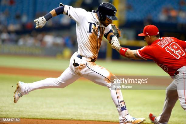 First baseman Jefry Marte of the Los Angeles Angels gets the out at first base on Kevin Kiermaier of the Tampa Bay Rays after Kiermaier hit a...