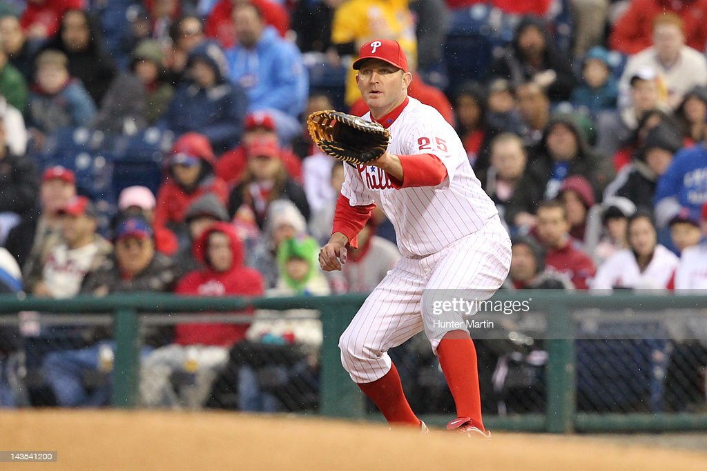 First baseman <a gi-track='captionPersonalityLinkClicked' href=/galleries/search?phrase=Jim+Thome&family=editorial&specificpeople=202878 ng-click='$event.stopPropagation()'>Jim Thome</a> #25 of the Philadelphia Phillies fields a throw from third base during a game against the Chicago Cubs at Citizens Bank Park on April 28, 2012 in Philadelphia, Pennsylvania. The Phillies won 5-2.