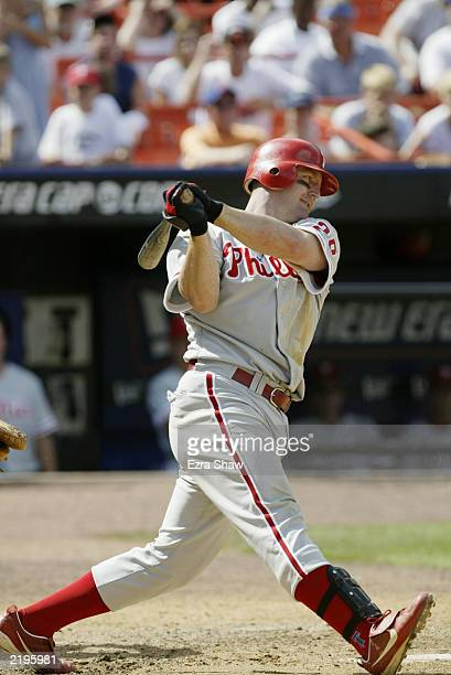 First baseman Jim Thome of the Philadelphia Phillies swings at a pitch during the National League game against the New York Mets at Shea Stadium on...