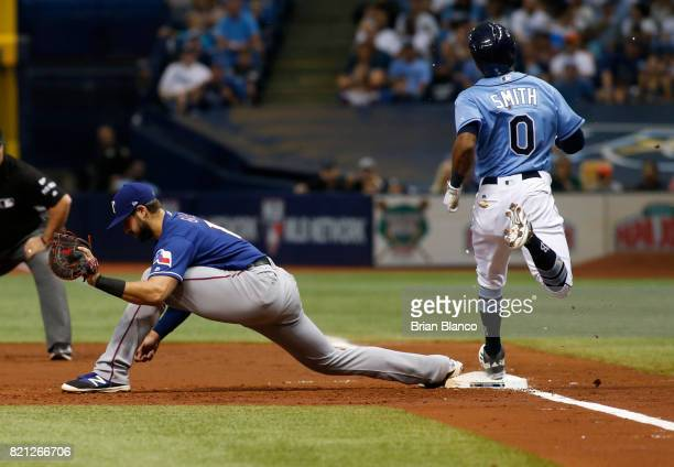 First baseman Joey Gallo of the Texas Rangers stretches to haul in the throw from shortstop Elvis Andrus to complete the double play with the out on...