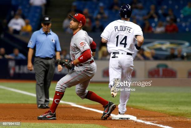 First baseman Joey Votto of the Cincinnati Reds hauls in the throw from second baseman Scooter Gennett to complete the double play with the out on...