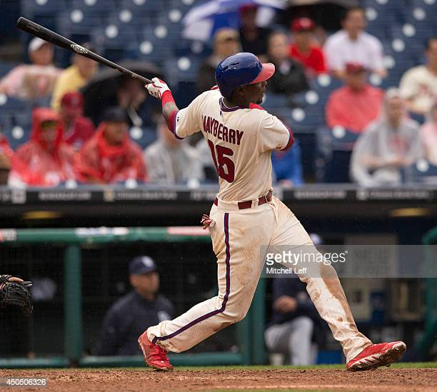 First baseman John Mayberry Jr #15 of the Philadelphia Phillies hits a three run home run in the bottom of the seventh inning against the San Diego...