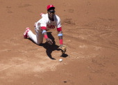 First baseman John Mayberry Jr #15 of the Philadelphia Phillies makes a diving stop and then flips the ball to pitcher AJ Burnett to get the out at...