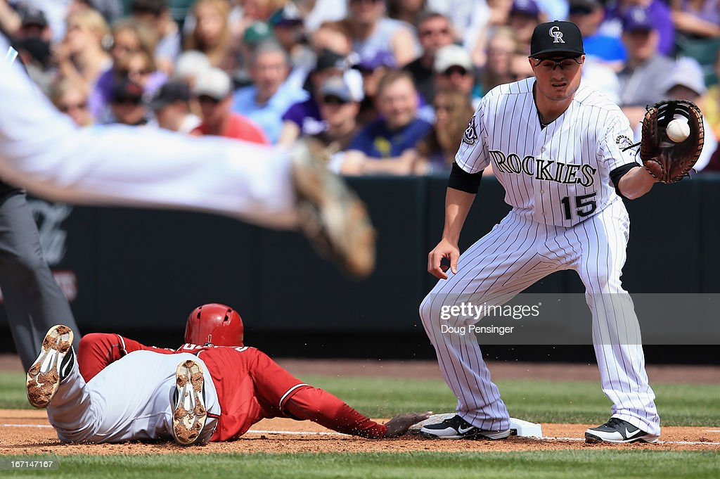 First baseman Jordan Pacheco #15 of the Colorado Rockies takes a pick off throw from pitcher Juan Nicasio #44 of the Colorado Rockies as Didi Gregorius #1 of the Arizona Diamondbacks slides safely back to first base at Coors Field on April 21, 2013 in Denver, Colorado.