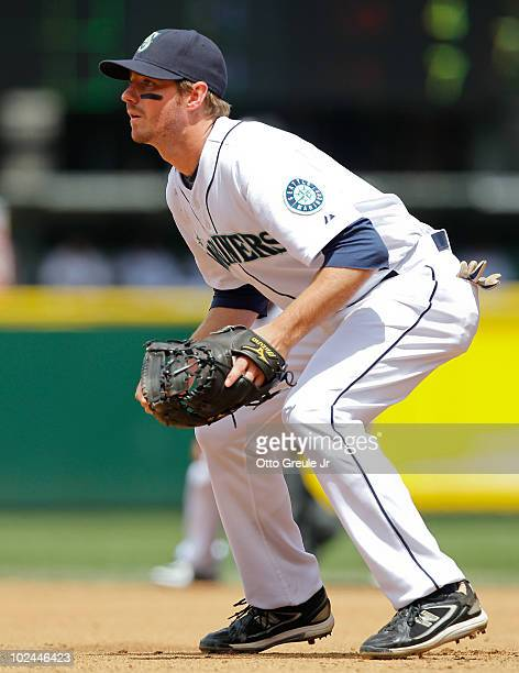 First baseman Josh Wilson of the Seattle Mariners watches the pitch during the game against the Chicago Cubs at Safeco Field on June 24 2010 in...