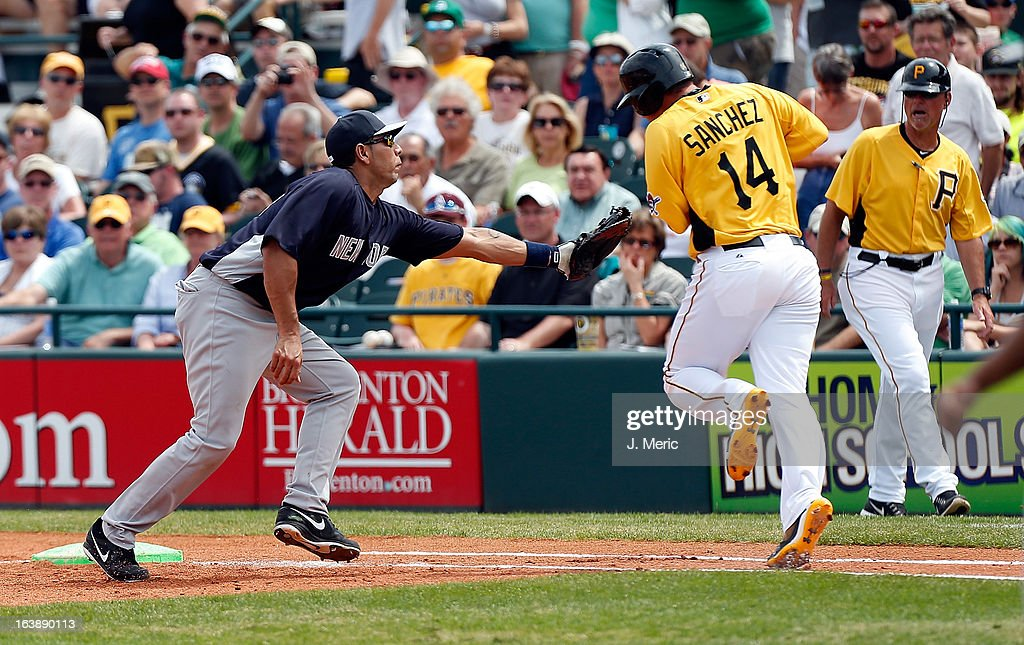First baseman Juan Rivera #54 of the New York Yankees tags out designated hitter Gaby Sanchez #14 of the Pittsburgh Pirates during a Grapefruit League Spring Training Game at McKechnie Field on March 17, 2013 in Bradenton, Florida.