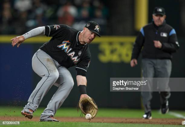 First baseman Justin Bour of the Miami Marlins fields a ground ball during a game against the Seattle Mariners at Safeco Field on April 17 2017 in...
