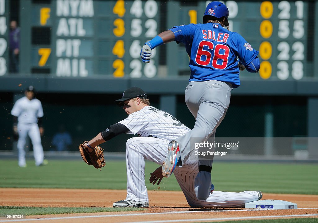 First baseman Justin Morneau #33 of the Colorado Rockies gets a put out as Jorge Soler #68 of the Chicago Cubs grounds out in the first inning at Coors Field on April 12, 2015 in Denver, Colorado.