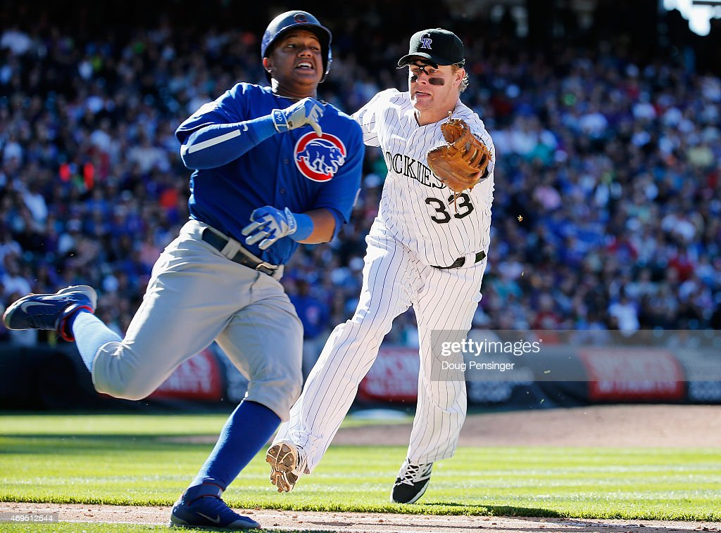 First baseman Justin Morneau #33 of the Colorado Rockies gets an unassisted put out as Starlin Castro #13 of the Chicago Cubs grounds out to him and is tagged out in the eighth inning at Coors Field on April 12, 2015 in Denver, Colorado. The Cubs defeated the Rockies 6-5.