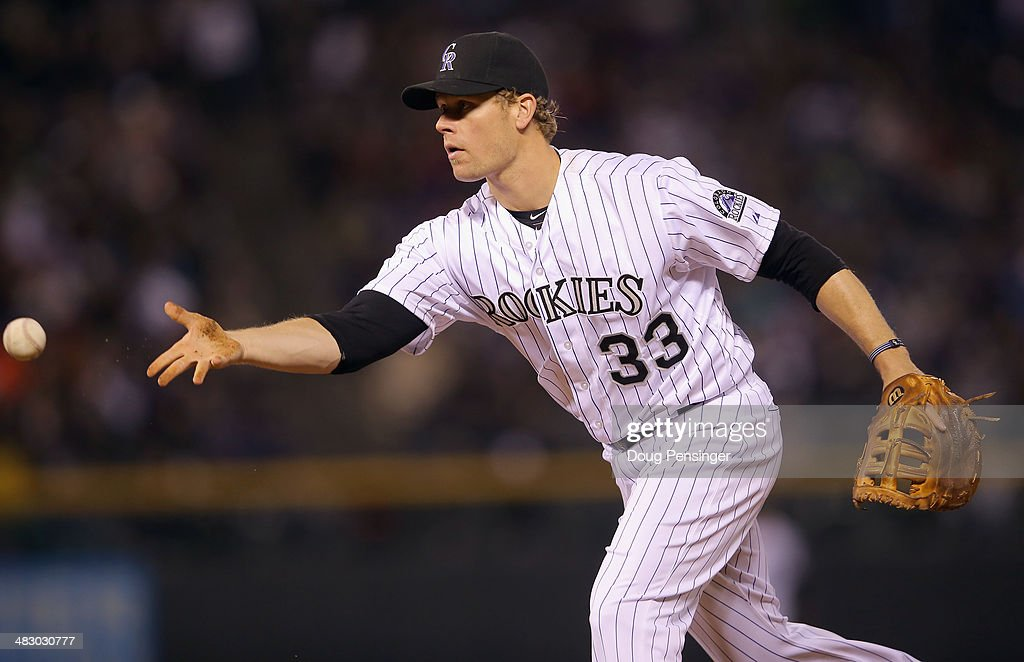First baseman Justin Morneau #33 of the Colorado Rockies records an assist against the Arizona Diamondbacks at Coors Field on April 5, 2014 in Denver, Colorado. The Rockies defeated the Diamondbacks 9-4.