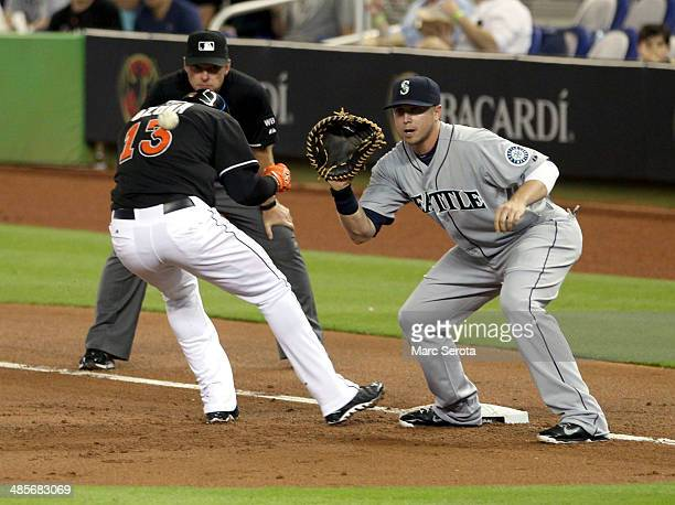First baseman Justin Smoak of the Seatle Mariners attempts to pick off runner Marcell Ozuna of the Miami Marlins during the second inning at Marlins...