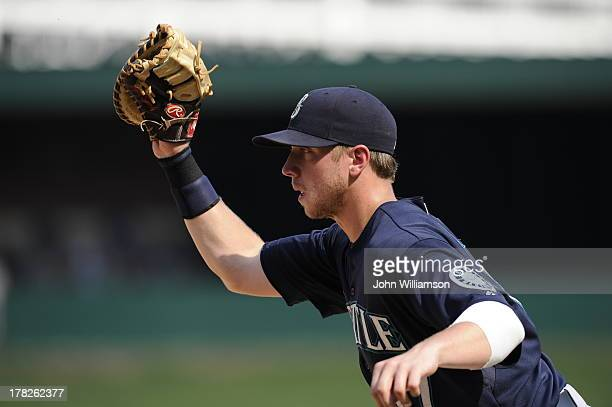 First baseman Justin Smoak of the Seattle Mariners fields his position as he catches a ground ball and looks for the pitcher covering first base in...