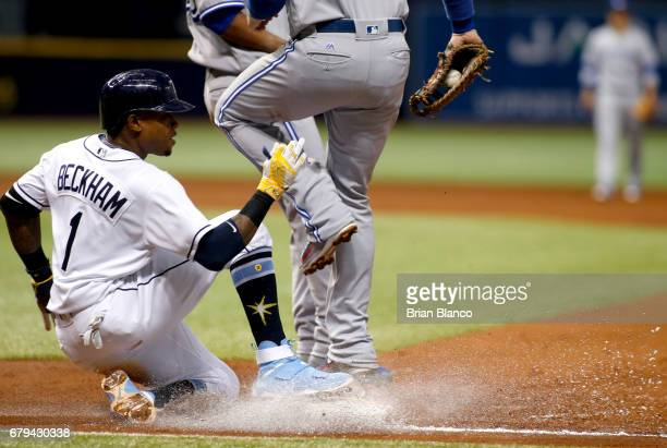 First baseman Justin Smoak of the Toronto Blue Jays gets the out at first base on Tim Beckham of the Tampa Bay Rays during the third inning of a game...