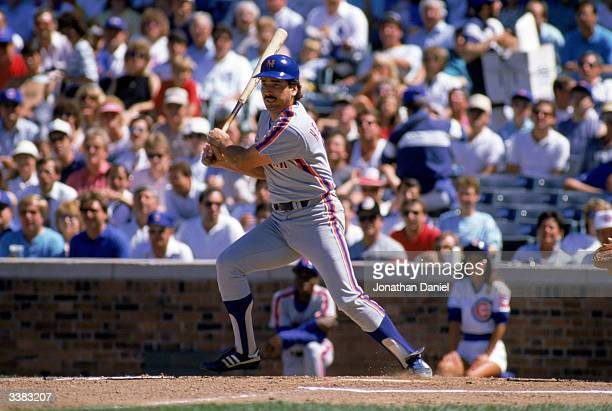 First baseman Keith Hernandez of the New York Mets swings during a 1988 game against the Chicago Cubs at Wrigley Field in Chicago Illinois