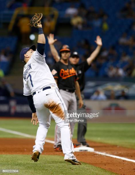 First baseman Logan Morrison of the Tampa Bay Rays fields the pop up into a forced out by Manny Machado of the Baltimore Orioles during the seventh...