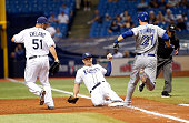 First baseman Logan Morrison of the Tampa Bay Rays gets the out at first base on Michael Saunders of the Toronto Blue Jays as Rays' pitcher Dana...