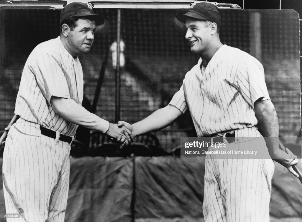 First baseman <a gi-track='captionPersonalityLinkClicked' href=/galleries/search?phrase=Lou+Gehrig&family=editorial&specificpeople=93714 ng-click='$event.stopPropagation()'>Lou Gehrig</a> #4 of the New York Yankees shakes hands with teammate <a gi-track='captionPersonalityLinkClicked' href=/galleries/search?phrase=Babe+Ruth&family=editorial&specificpeople=94423 ng-click='$event.stopPropagation()'>Babe Ruth</a> #3 circa 1923-34.