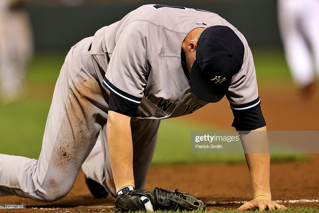 First baseman <a gi-track='captionPersonalityLinkClicked' href=/galleries/search?phrase=Lyle+Overbay&family=editorial&specificpeople=214072 ng-click='$event.stopPropagation()'>Lyle Overbay</a> #55 of the New York Yankees lays on the ground after missing a hit in the fifth inning against the Baltimore Orioles at Oriole Park at Camden Yards on June 30, 2013 in Baltimore, Maryland. The Baltimore Orioles won, 4-2.