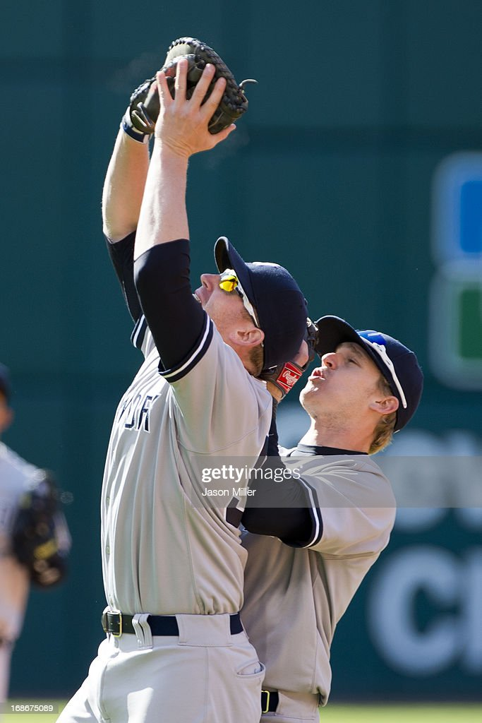 First baseman <a gi-track='captionPersonalityLinkClicked' href=/galleries/search?phrase=Lyle+Overbay&family=editorial&specificpeople=214072 ng-click='$event.stopPropagation()'>Lyle Overbay</a> #55 runs into second baseman Corban Joseph #61 of the New York Yankees as while catching a fly ball hit by Mark Reynolds #12 of the Cleveland Indians to end the 6i\ during the second game of a doubleheader at Progressive Field on May 13, 2013 in Cleveland, Ohio.