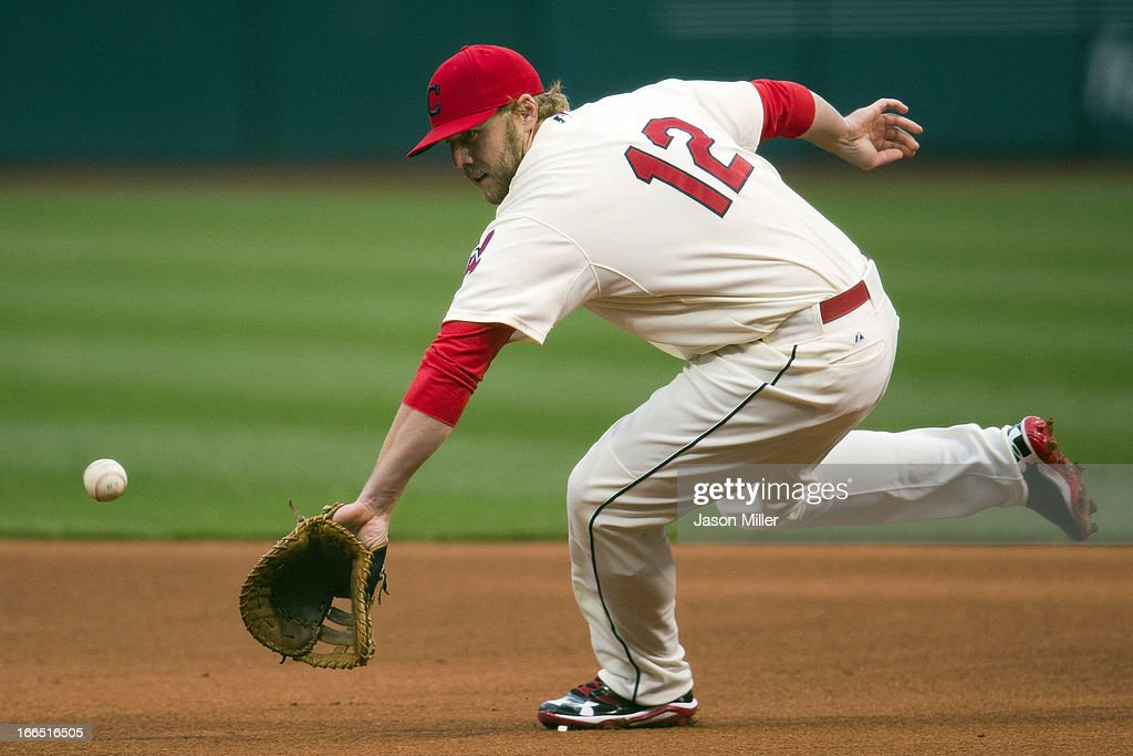 First baseman <a gi-track='captionPersonalityLinkClicked' href=/galleries/search?phrase=Mark+Reynolds&family=editorial&specificpeople=2343799 ng-click='$event.stopPropagation()'>Mark Reynolds</a> #12 of the Cleveland Indians fields a ground ball hit by Alex Rios #51 of the Chicago White Sox during the first inning at Progressive Field on April 13, 2013 in Cleveland, Ohio.