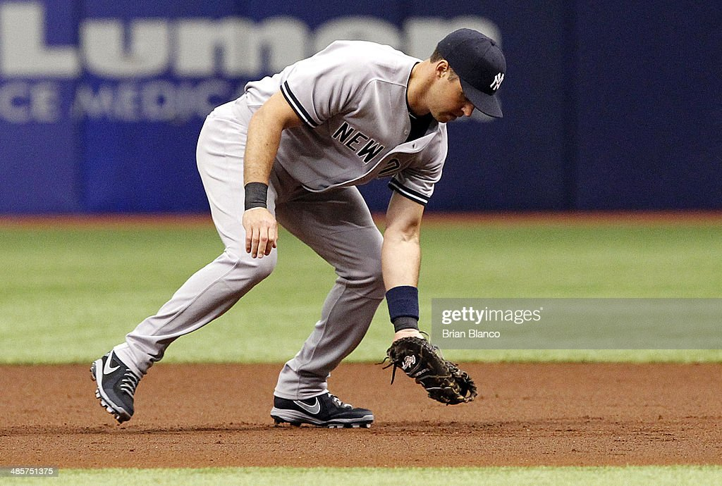First baseman Mark Teixeira #25 of the New York Yankees catches a liner by Sean Rodriguez of the Tampa Bay Rays during first inning of a game on April 20, 2014 at Tropicana Field in St. Petersburg, Florida.