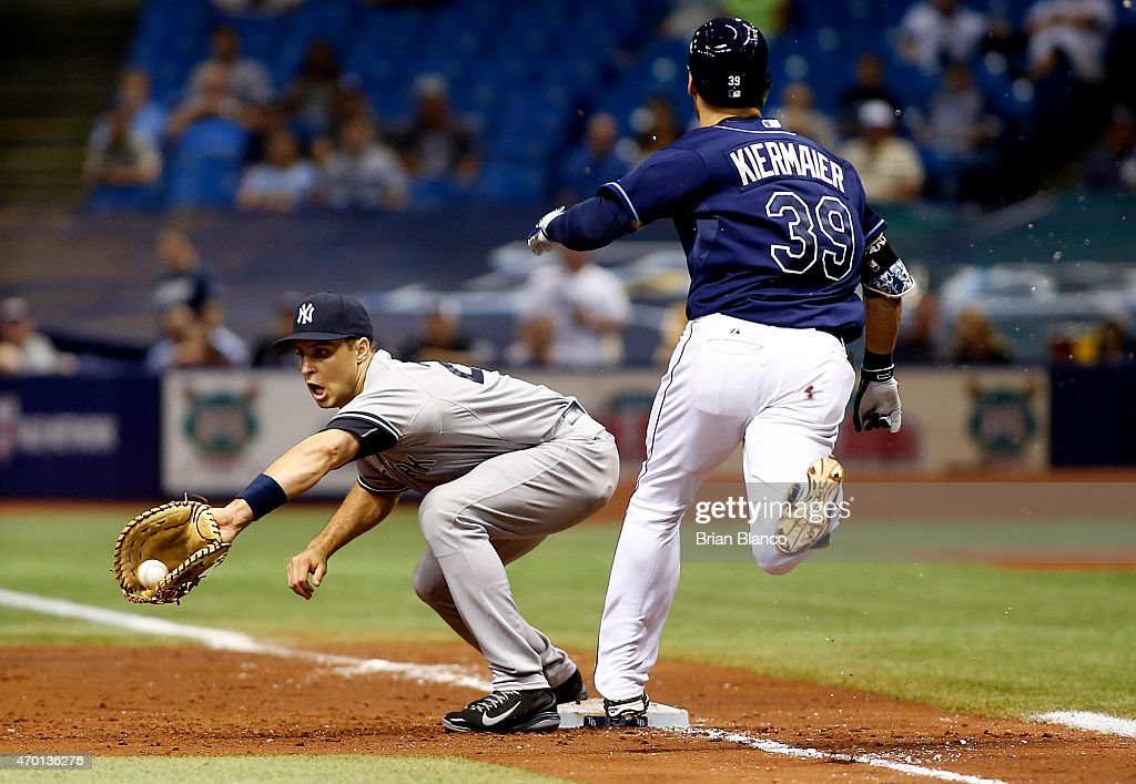 First baseman Mark Teixeira of the New York Yankees hauls in the throw from pitcher Adam Warren for the out on Kevin Kiermaier of the Tampa Bay Rays...