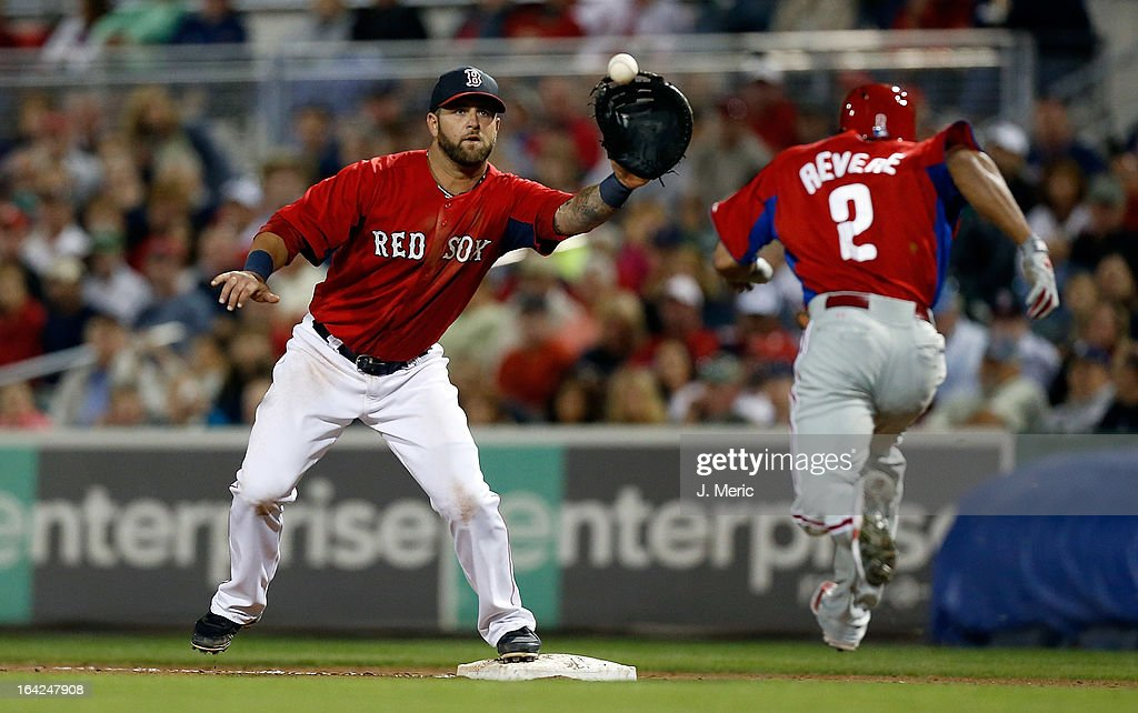 First baseman <a gi-track='captionPersonalityLinkClicked' href=/galleries/search?phrase=Mike+Napoli&family=editorial&specificpeople=525007 ng-click='$event.stopPropagation()'>Mike Napoli</a> #12 of the Boston Red Sox takes the throw at first as outfielder <a gi-track='captionPersonalityLinkClicked' href=/galleries/search?phrase=Ben+Revere&family=editorial&specificpeople=6826641 ng-click='$event.stopPropagation()'>Ben Revere</a> #2 of the Philadelphia Phillies cannot beat the throw during a Grapefruit League Spring Training Game at JetBlue Park on March 21, 2013 in Fort Myers, Florida.