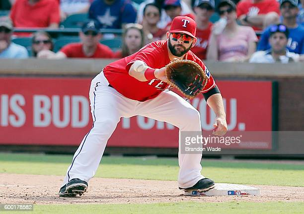 First baseman Mitch Moreland of the Texas Rangers catches a throw during a baseball game against the Houston Astros at Globe Life Park in Arlington...