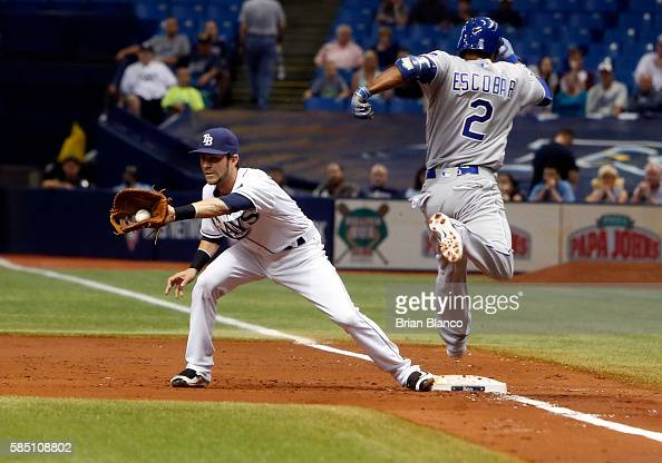 First baseman Nick Franklin of the Tampa Bay Rays hauls in the throw from third baseman Evan Longoria of the Tampa Bay Rays for the out at first on...
