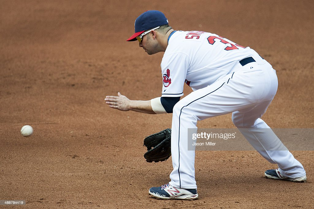 First baseman <a gi-track='captionPersonalityLinkClicked' href=/galleries/search?phrase=Nick+Swisher&family=editorial&specificpeople=206417 ng-click='$event.stopPropagation()'>Nick Swisher</a> #33 of the Cleveland Indians fields a ground ball hit by Eduardo Escobar #5 of the Minnesota Twins during the fourth inning at Progressive Field on May 8, 2014 in Cleveland, Ohio.