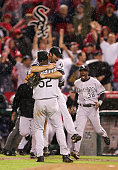 First baseman Paul Konerko and pitcher Jose Contreras of the Chicago White Sox embrace as the White Sox win the American League Pennant 63 against...
