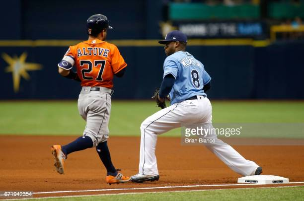 First baseman Rickie Weeks of the Tampa Bay Rays gets the out at first base on Jose Altuve of the Houston Astros after Altuve grounded out to the...