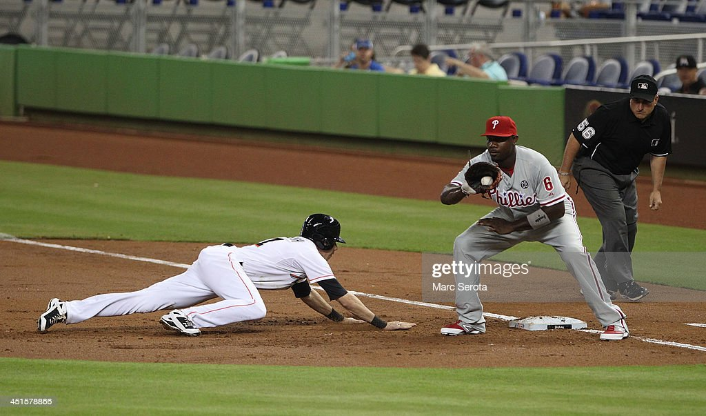 First baseman Ryan Howard #6 of the Philadelphia Phillies attempts to pick off Christian Yelich #21 of the Miami Marlins during the first inning at Marlins Park on July 1, 2014 in Miami, Florida.